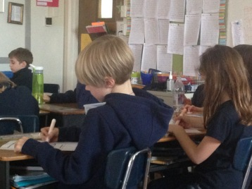 Students work on an activity about preparation for First Communion.